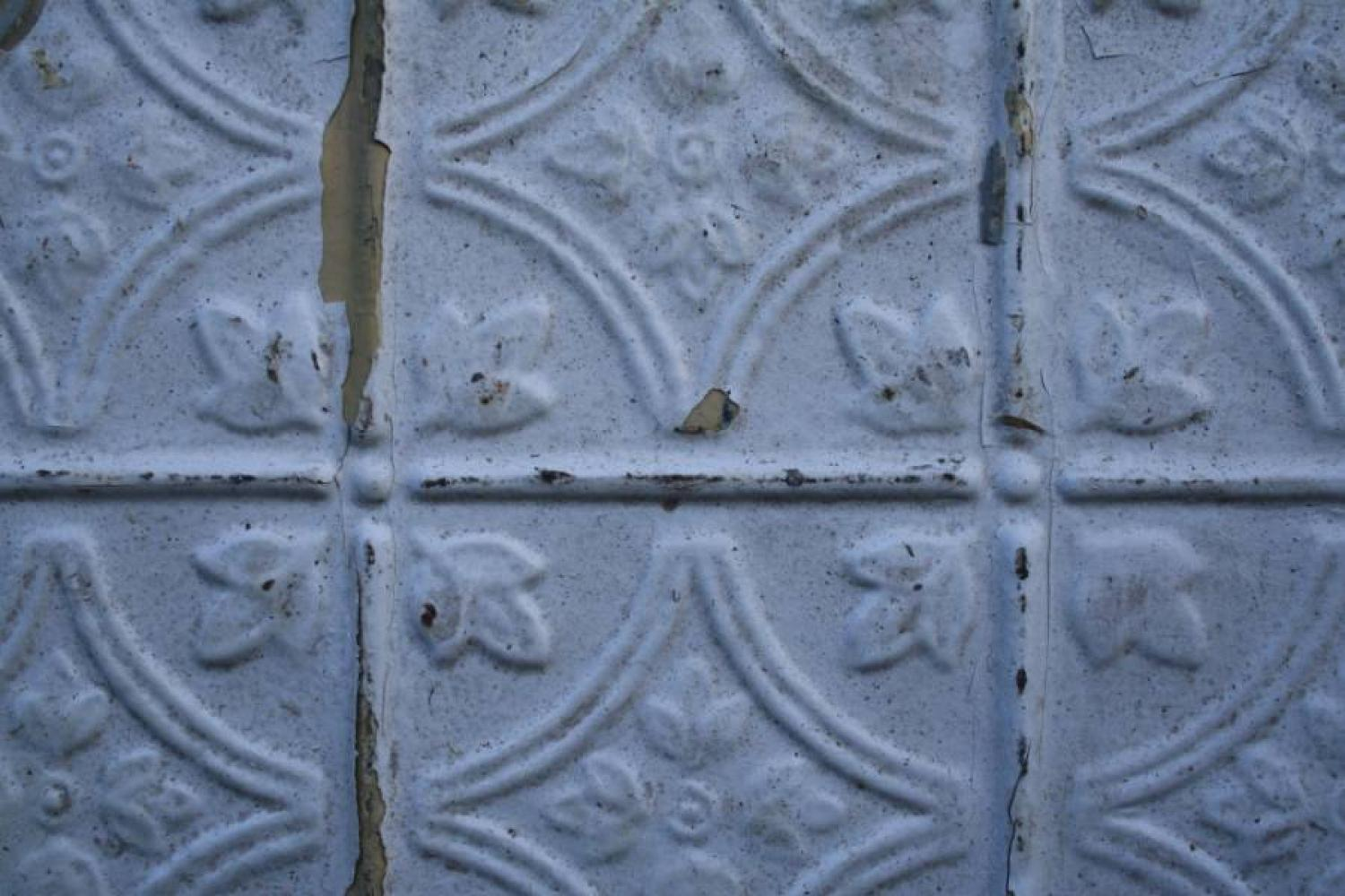 Tin sheet with embossed tile pattern