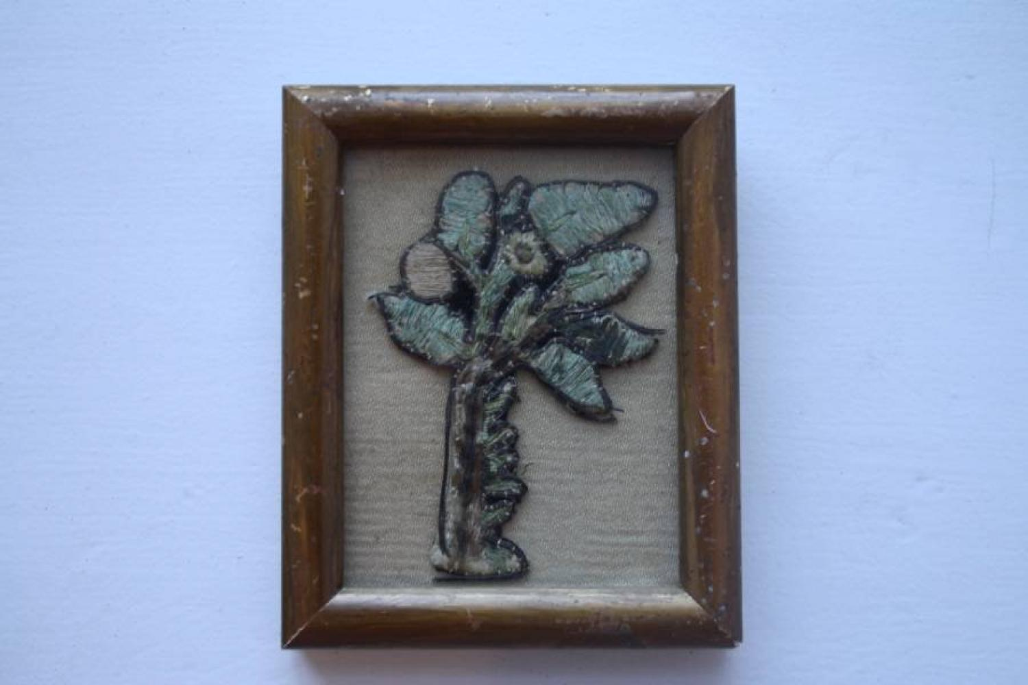17th C textile in frame