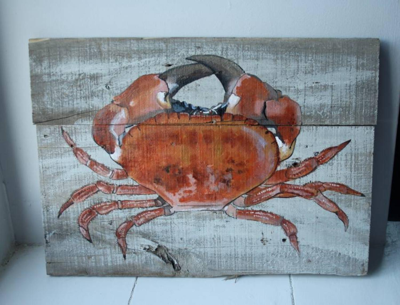 Handpainted crab on old floorboards