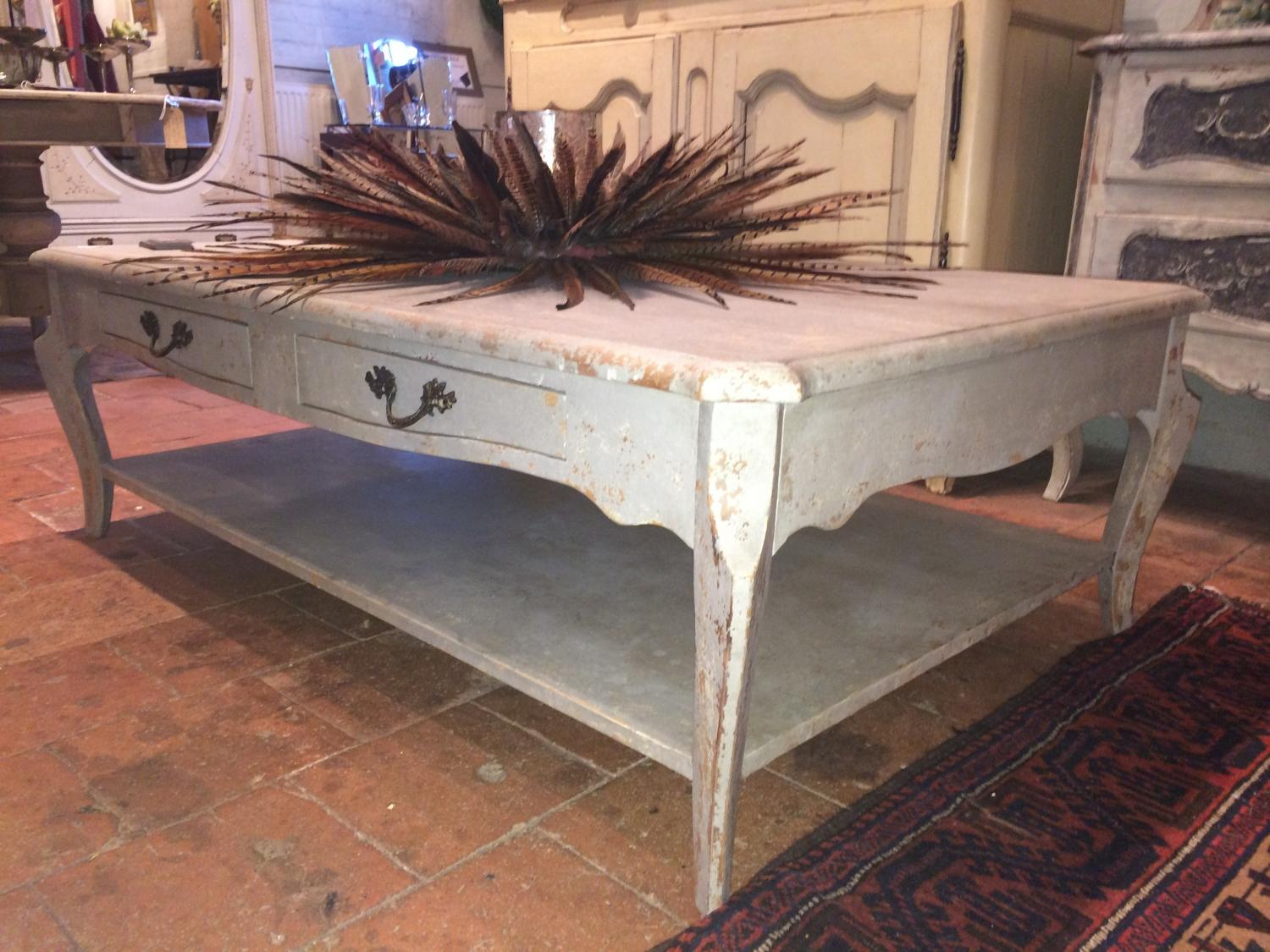 Large painted coffee table with lower shelf