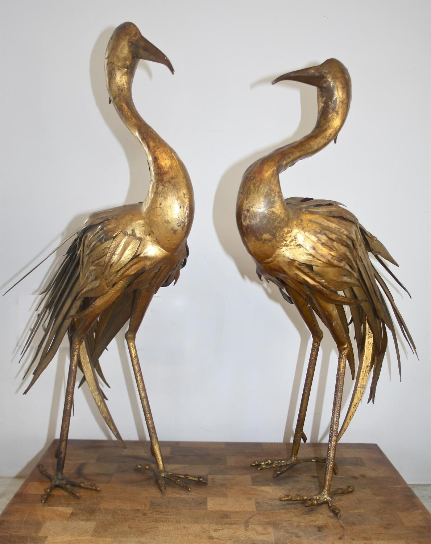Pair of gilt storks