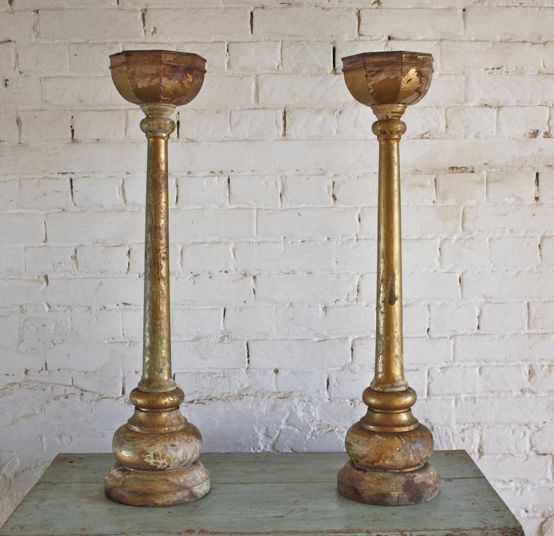 Pair of wooden gilt candlesticks