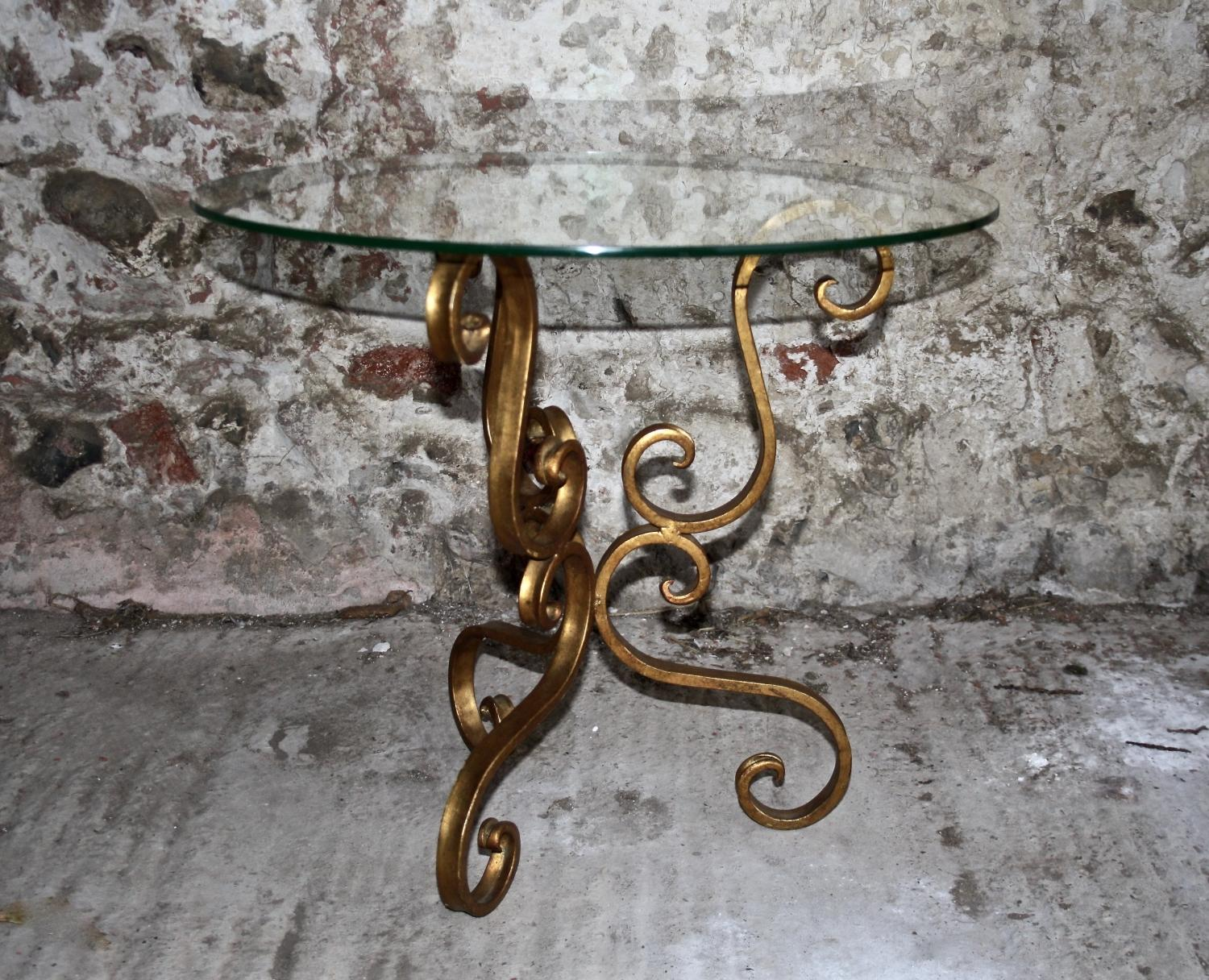 Glass topped, metal based side table