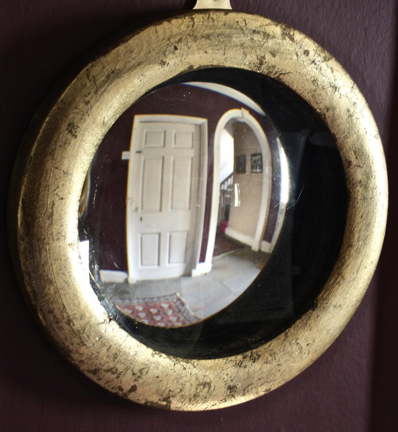 Circular concave mirror with gilt frame