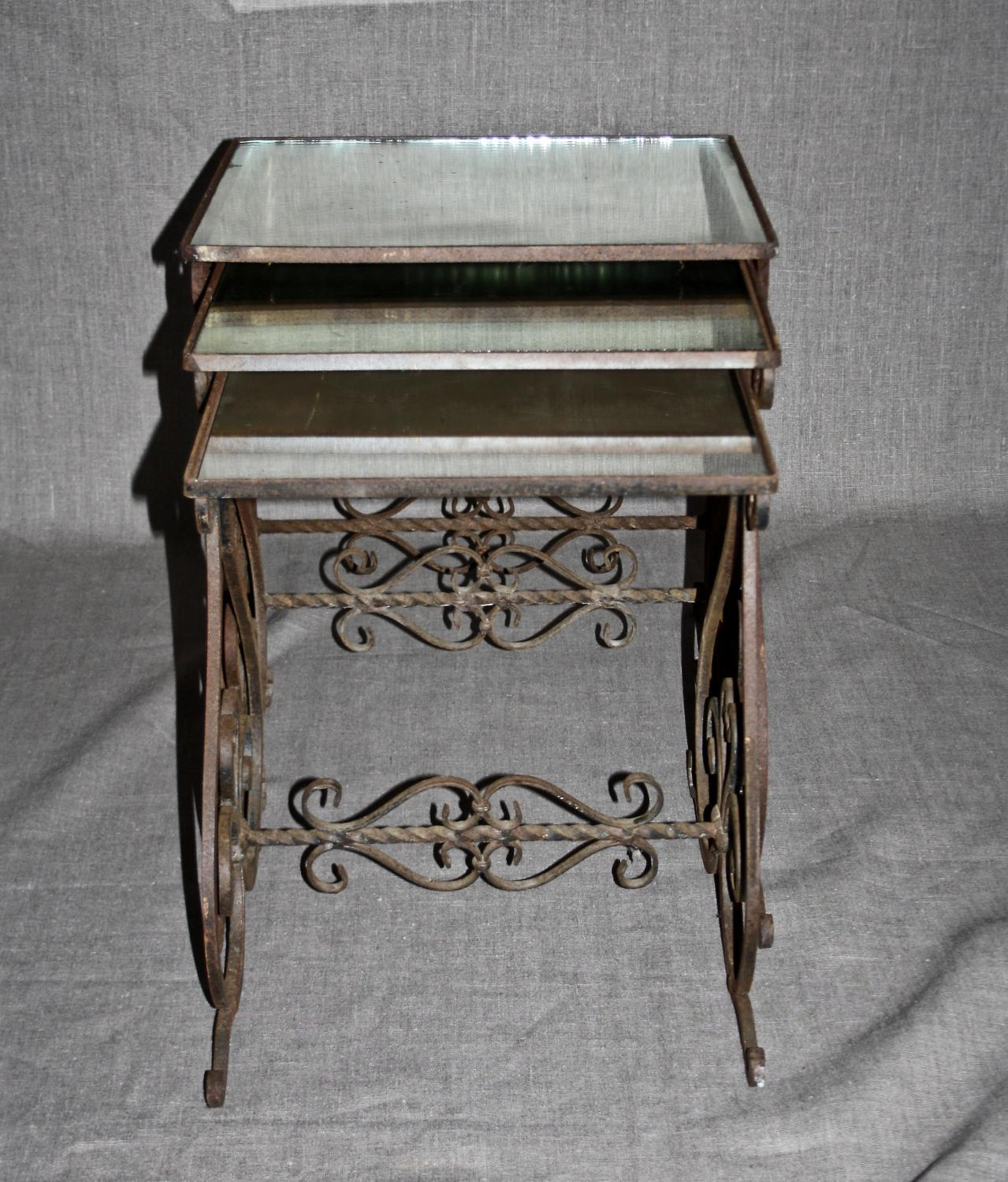 Nest of mirror top wrought iron tables