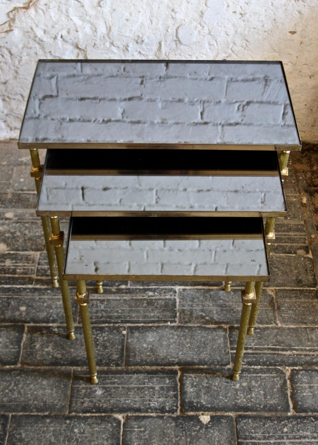 Nest of 1950's brass and mirror top tables