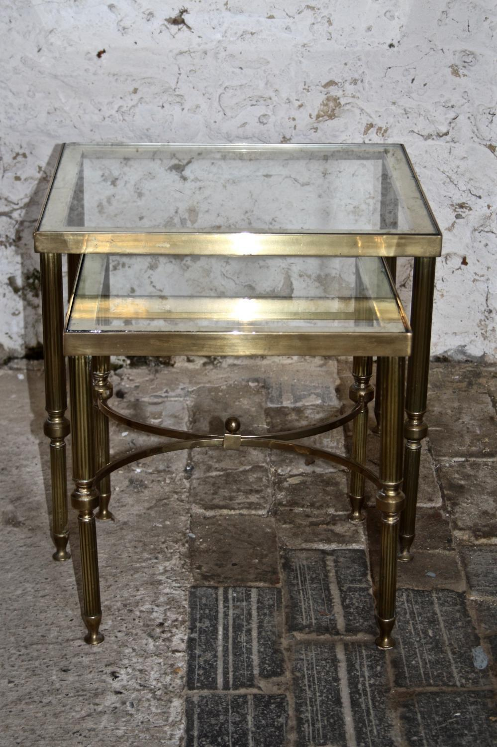 Two matching glass top brass side tables