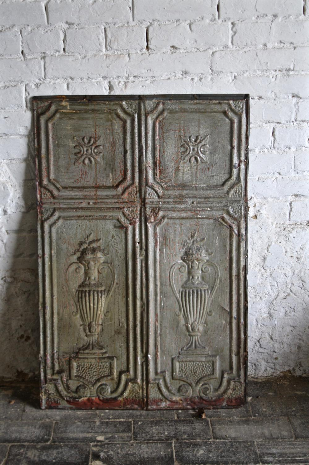 Tin panel with urns