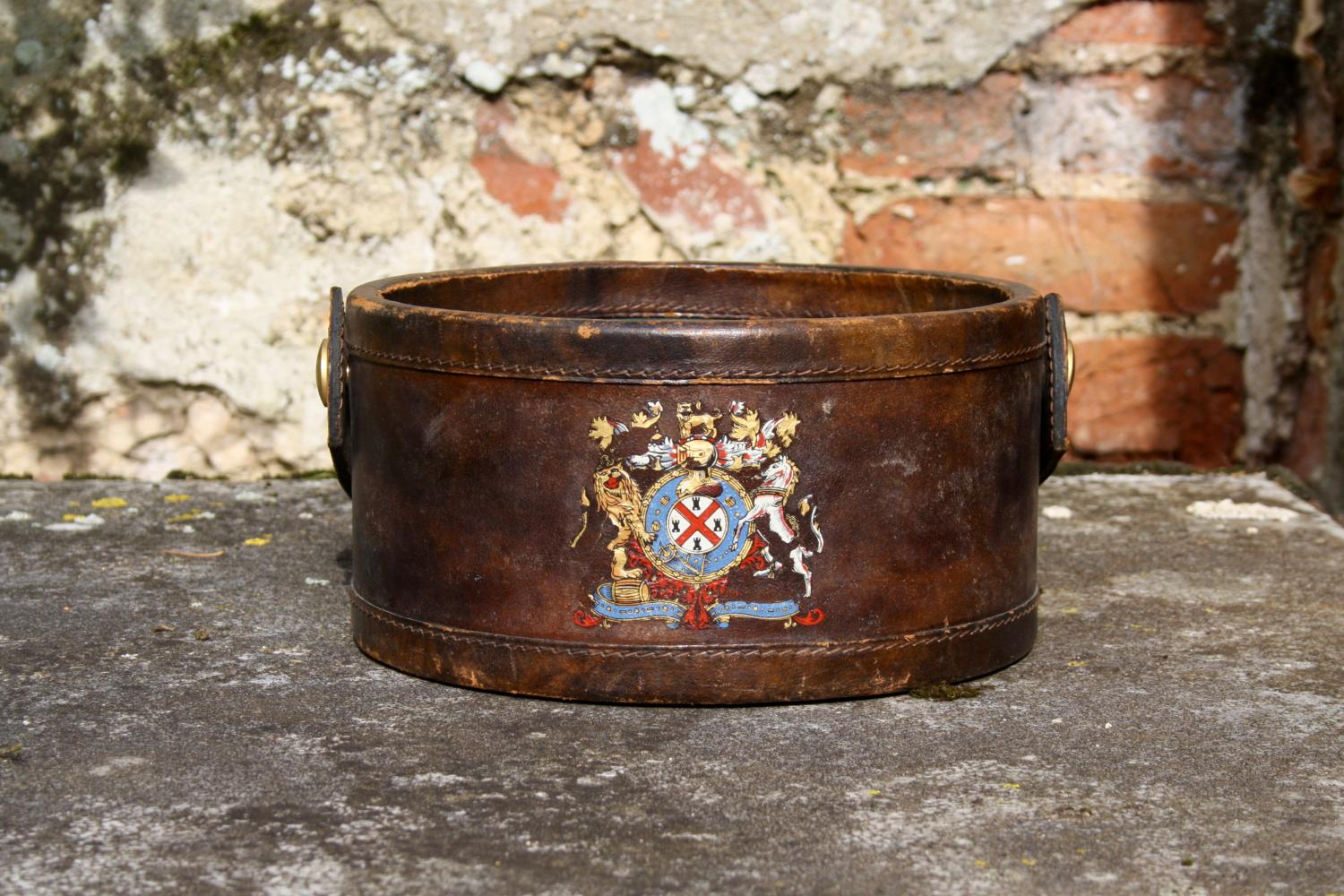 Small leather bucket with crest decoration