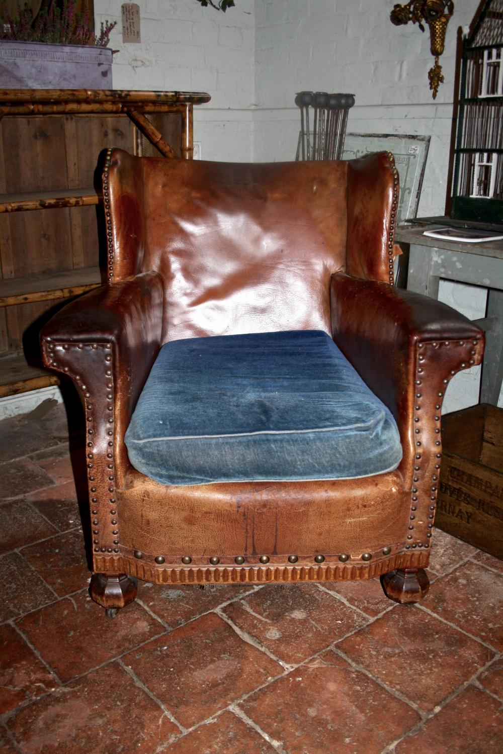 Leather gentleman's chair with cushion
