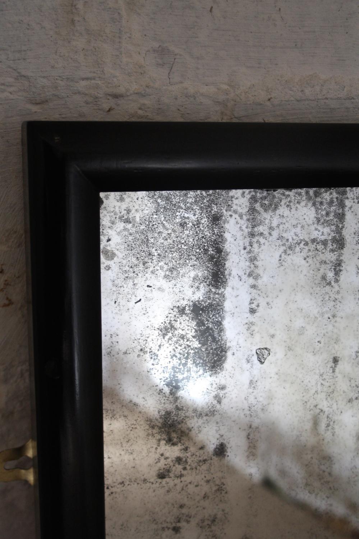 Black haberdashery mirror