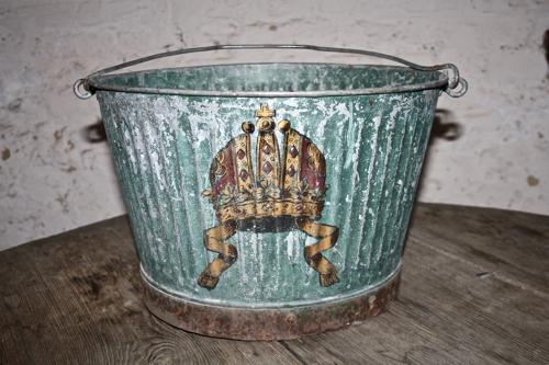 Metal bucket with crown painting