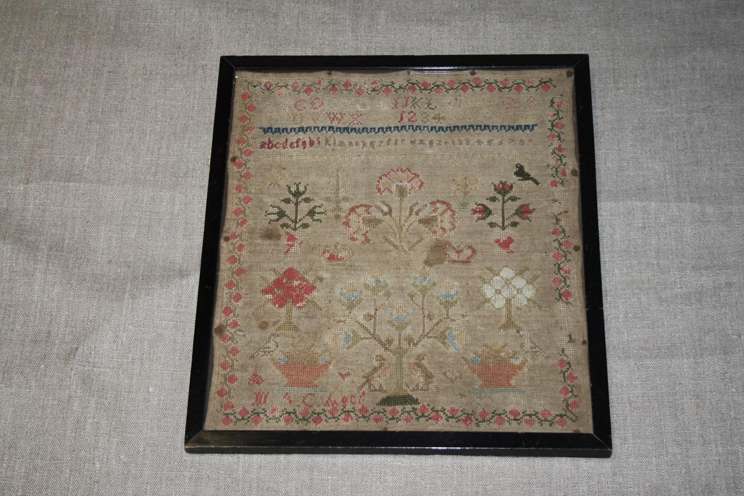 19th century sampler in original frame