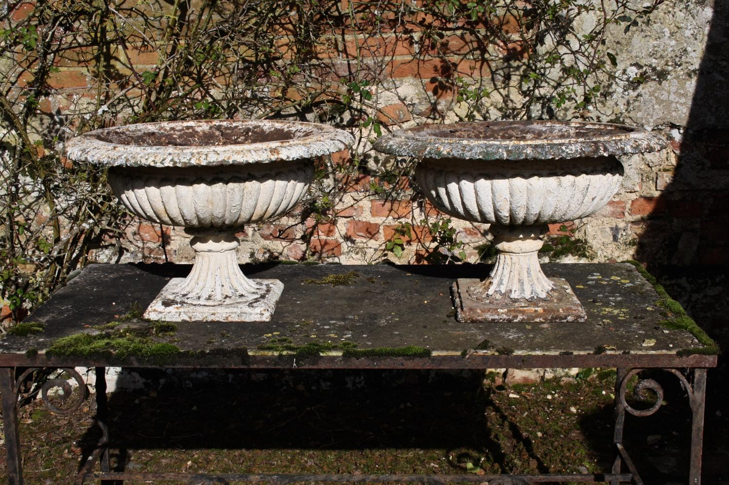 Pair of cast Victorian urns