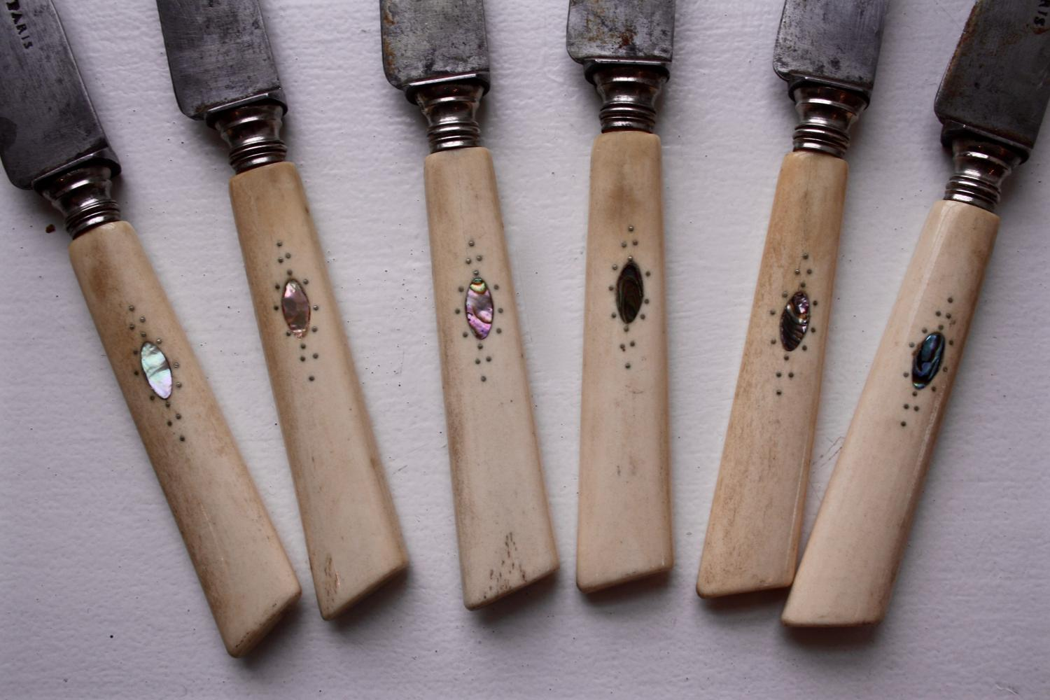 Bone handled knives with mother of pearl inla