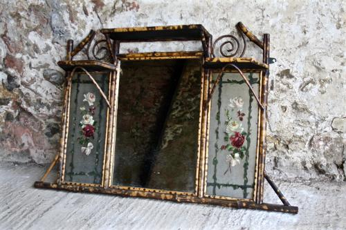 Bamboo mirror with floral glass panels