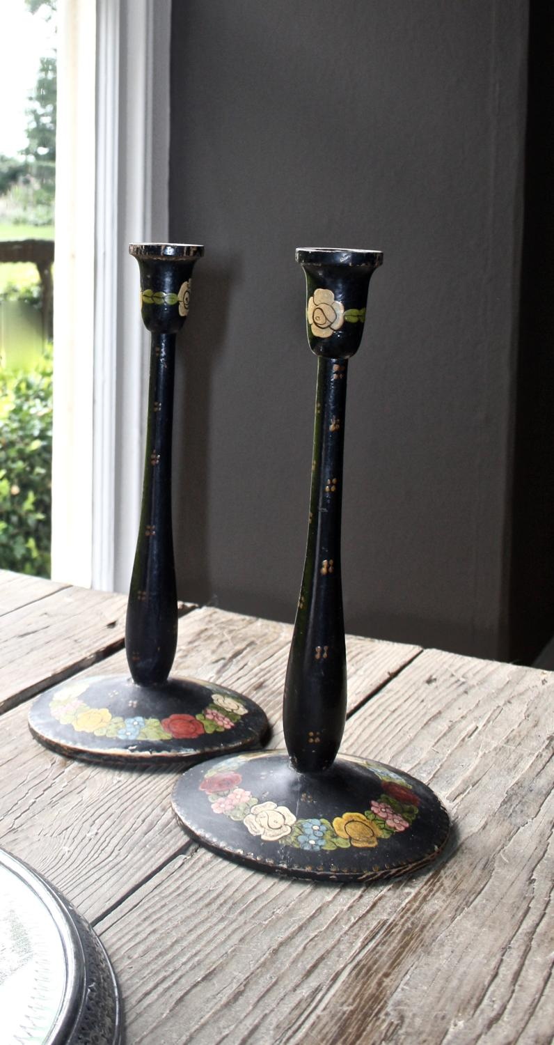 Pair of painted wooden candlesticks