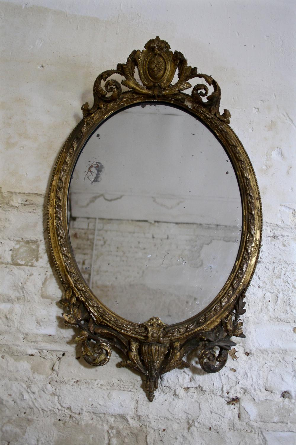 19th century oval gilt mirror
