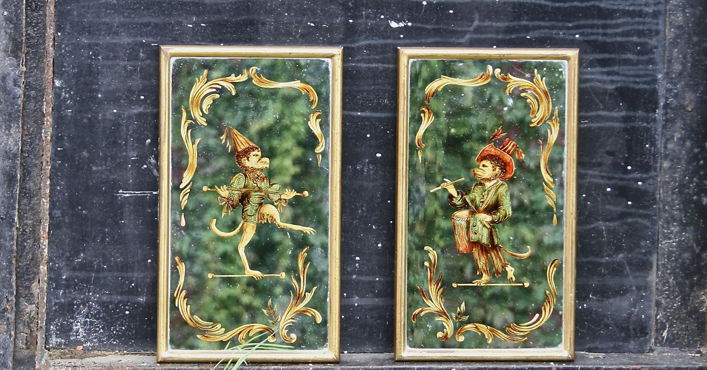 Pair of reverse painted Venetian mirrors