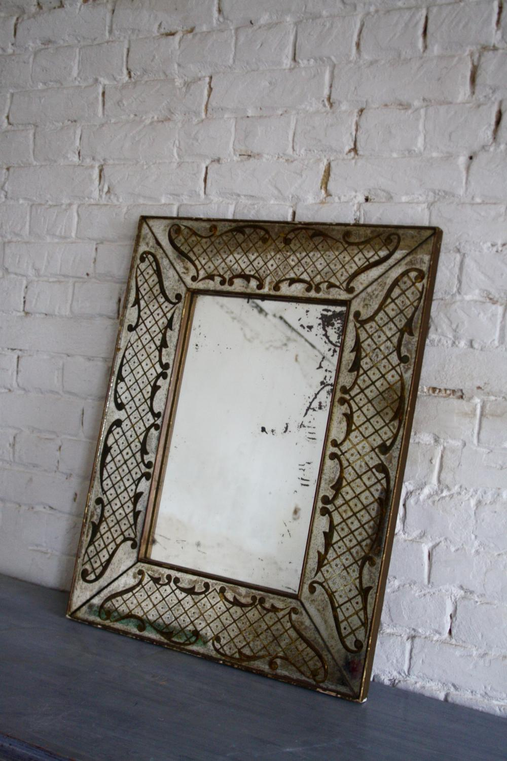 19th century French mirror with gilding decoration