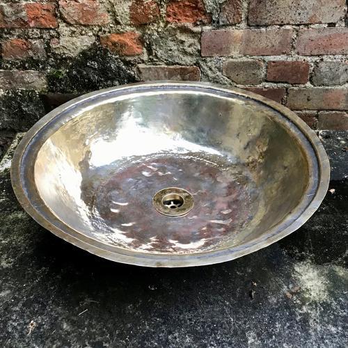Round brass sink