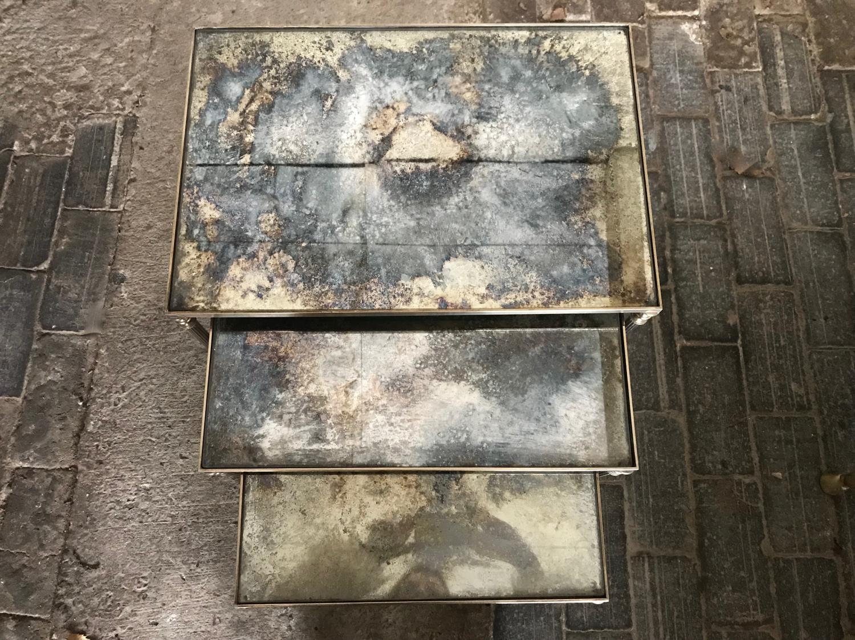 Nest of verre eglomise mid century brass tables