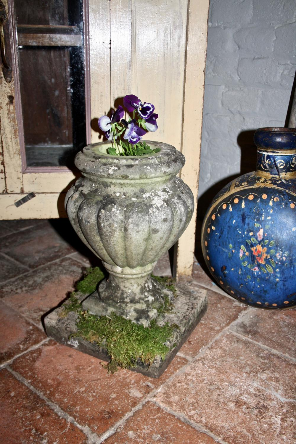 Lichen covered early 20th century marble urn