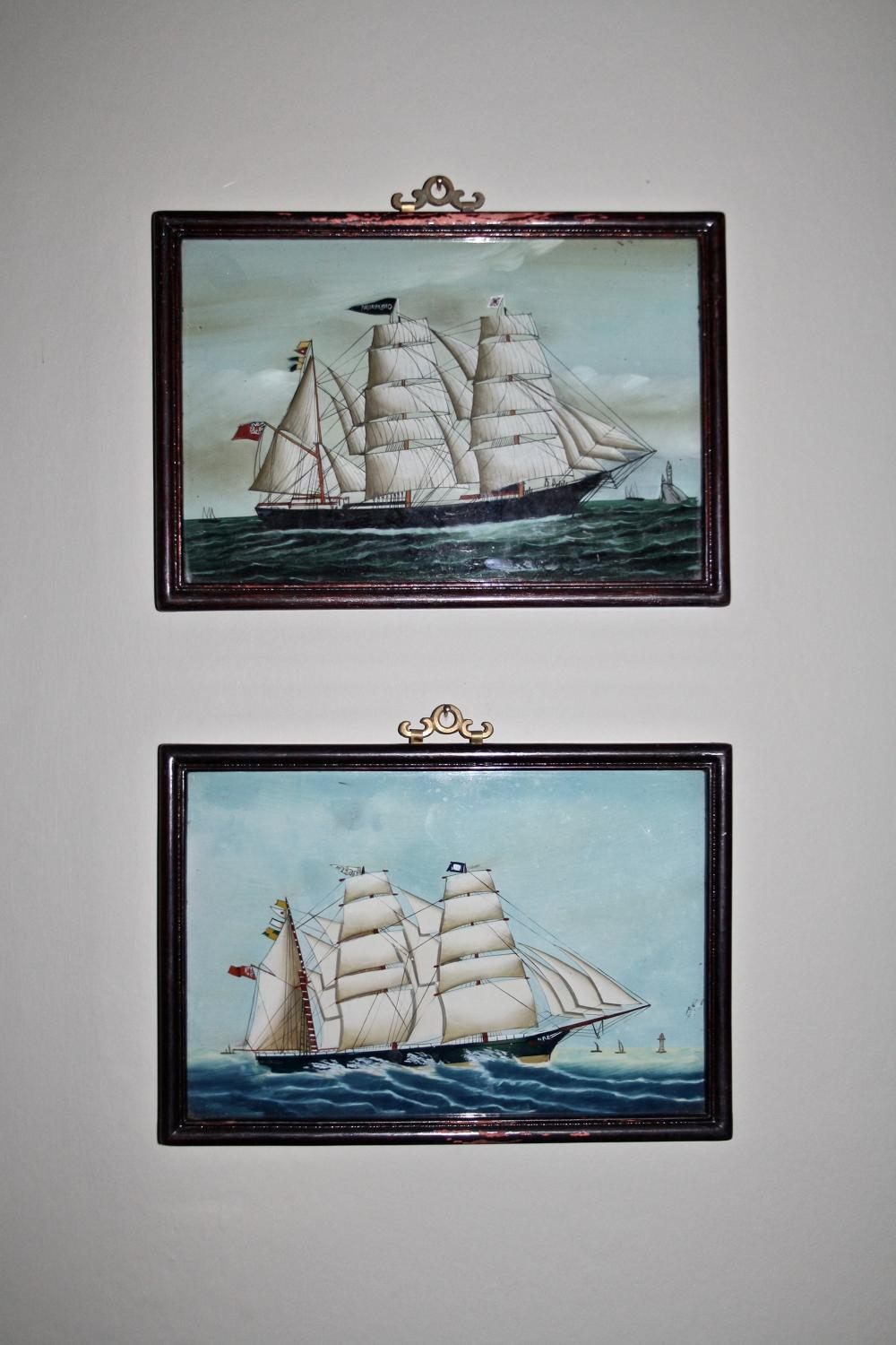 Pair of reverse glass painted pictures
