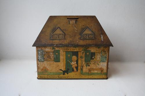 Cottage shaped Crawfords biscuit tin money box
