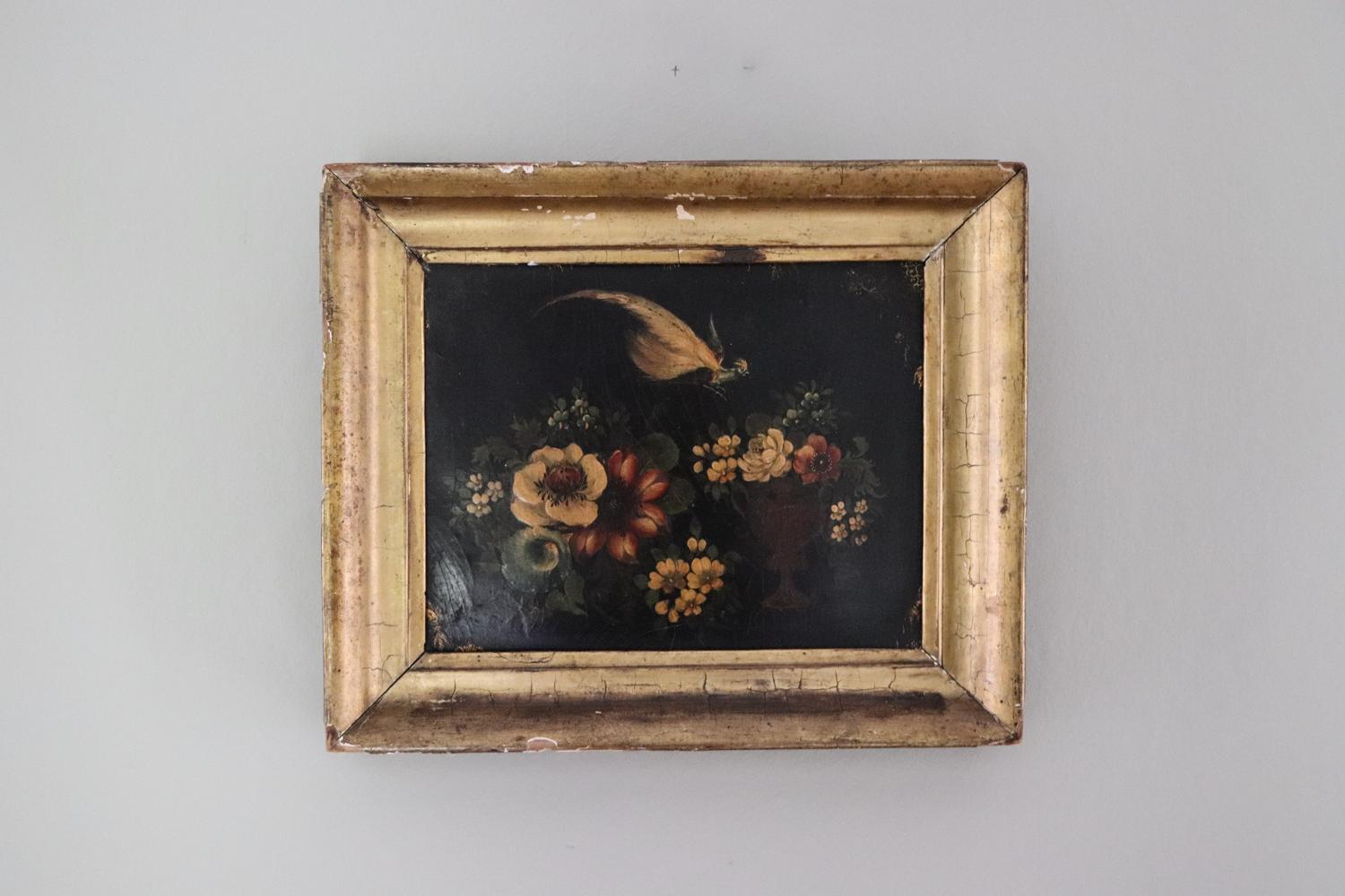Painted wooden panel in gilt frame