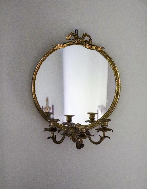 1950s round gilt framed girandole mirror