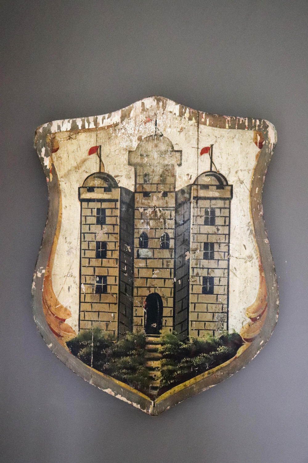 Wooden shield with painting of a castle