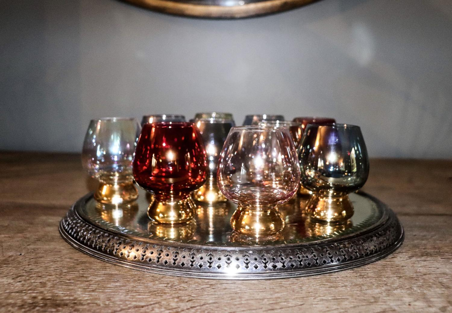 Ten vintage iridescent brandy glasses