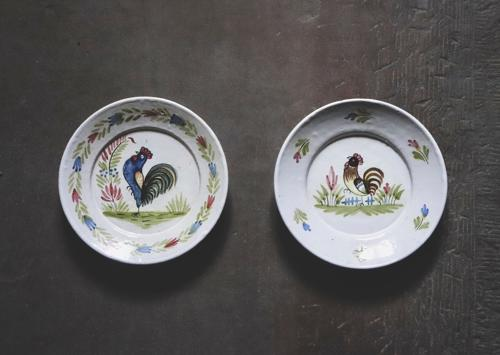 Pair of plates depicting a cockerel and a hen