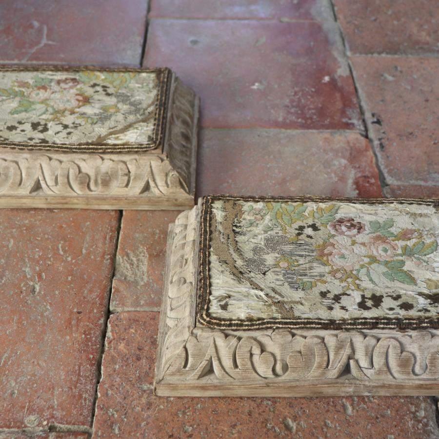 Pair of tapestry topped carved wooden bases