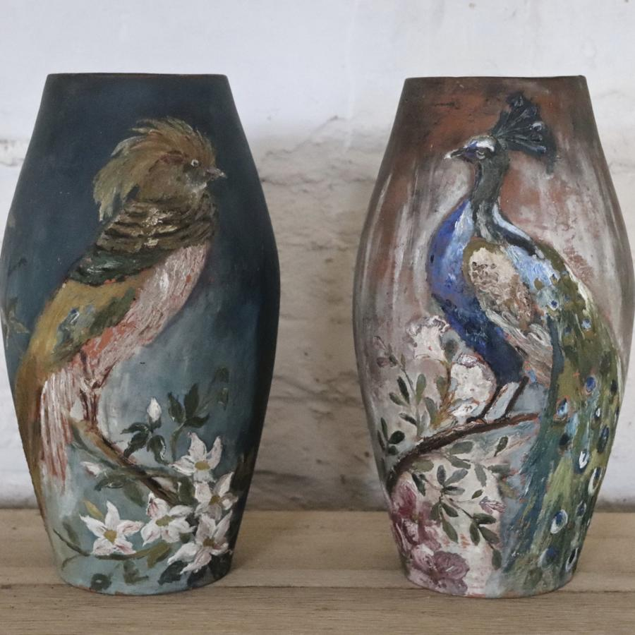 Pair of terracotta vases with birds