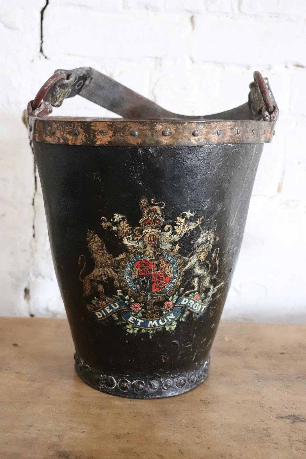 19th century fire bucket with crest