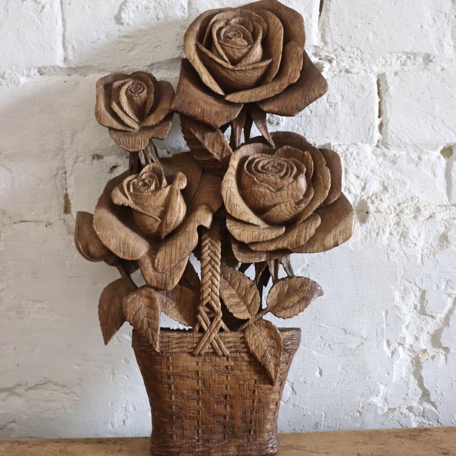 Wooden carving of roses in a basket