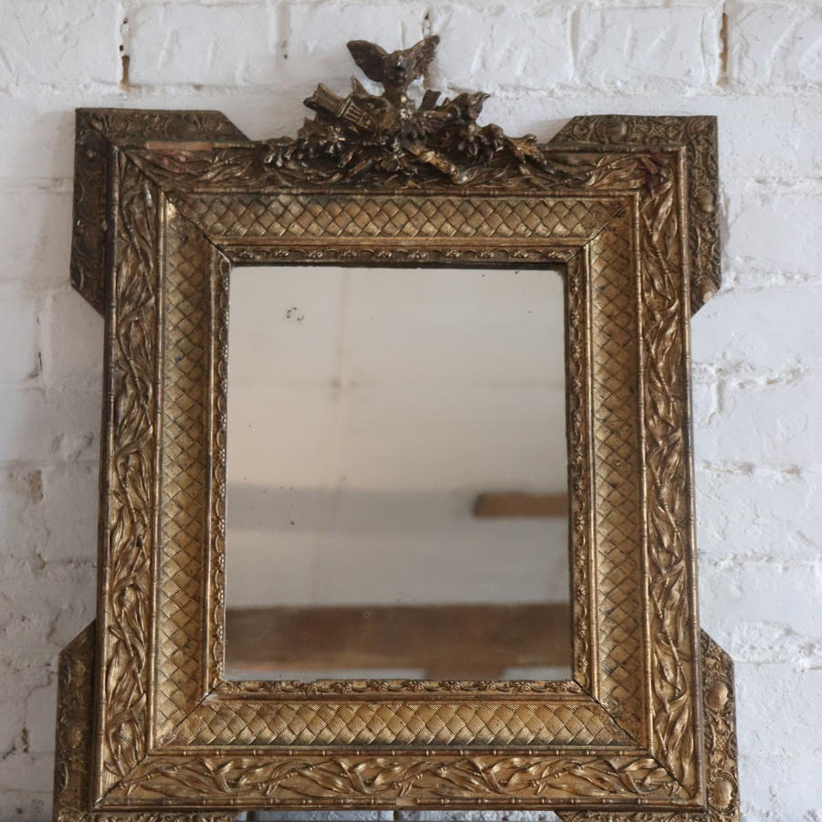 Gilt framed 19th century mirror with bird carving