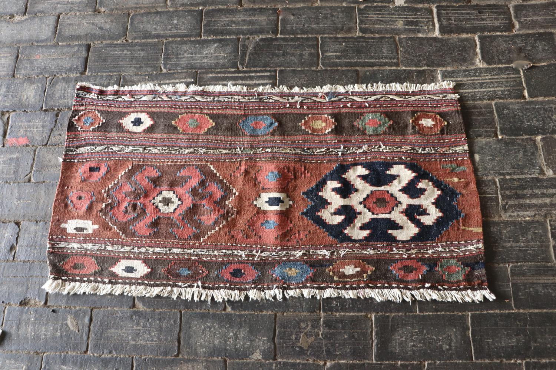 Small pink kilim rug