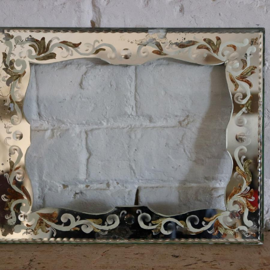 Vintage glass frame with painted mirrored edging