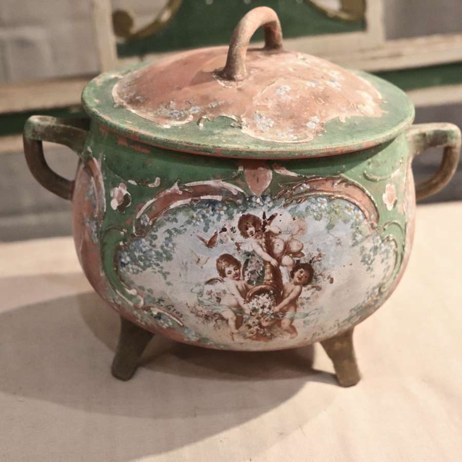 Terracotta pot with cherub decoration