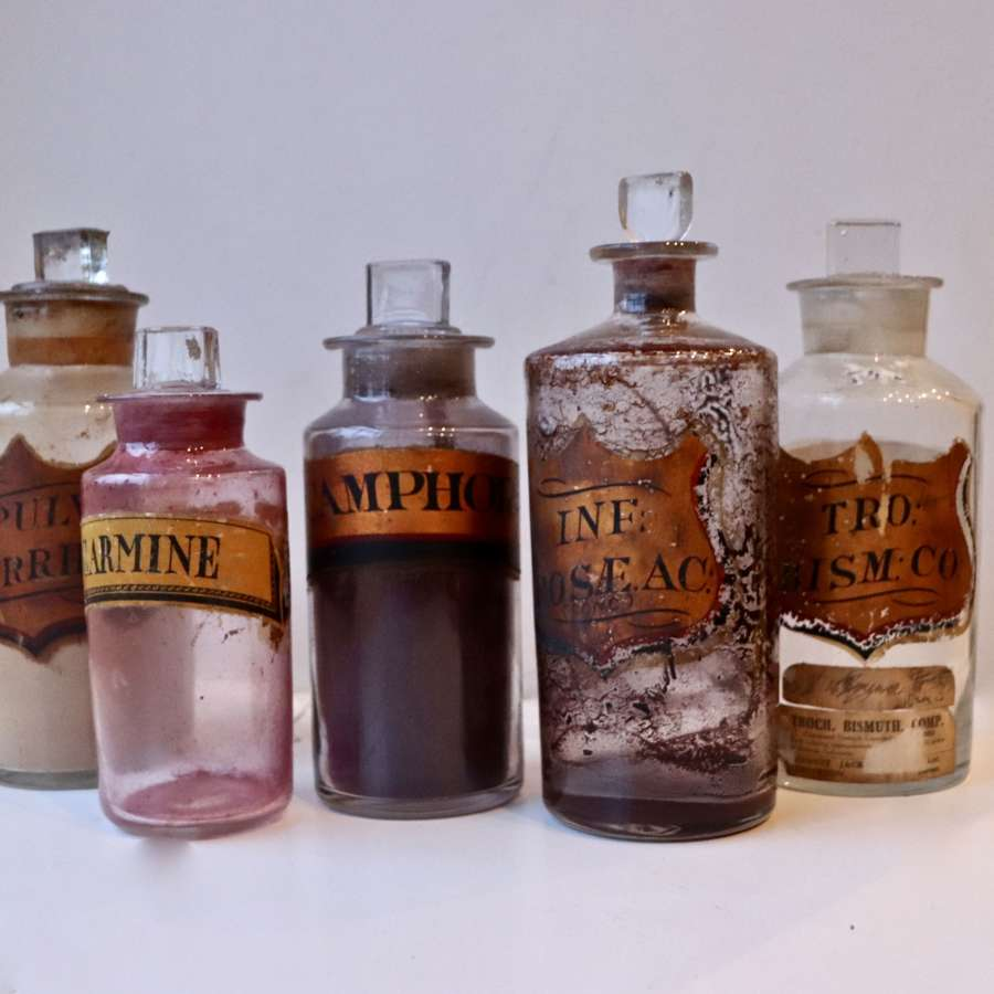 Set of five decorative chemist bottles
