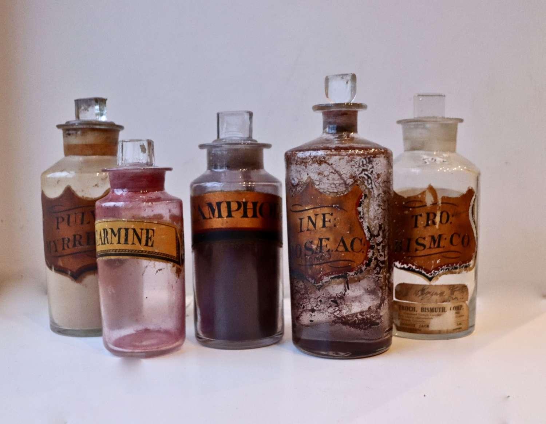 Set of five decorative chemist bottles