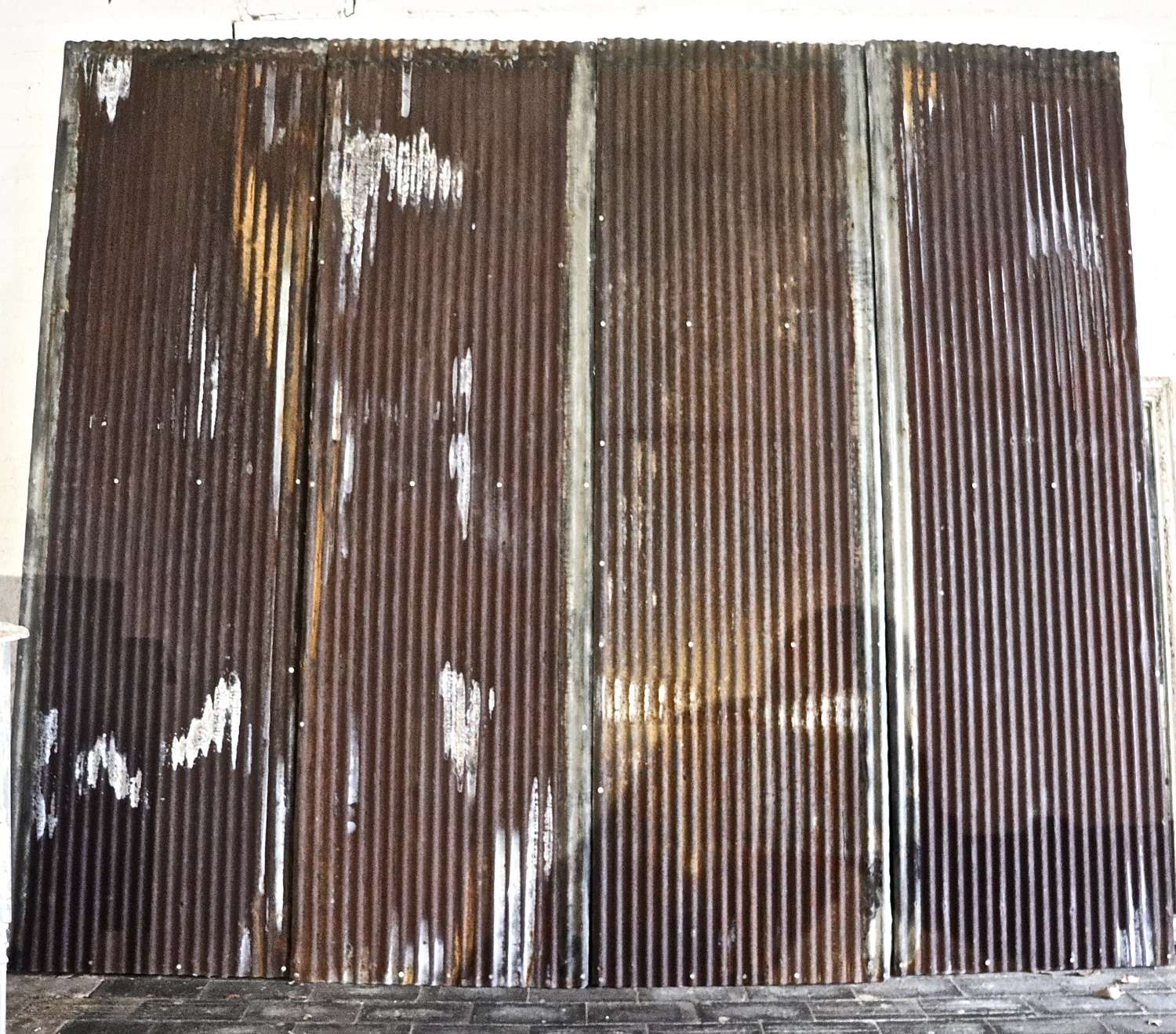 Corrugated iron panels on wooden frames