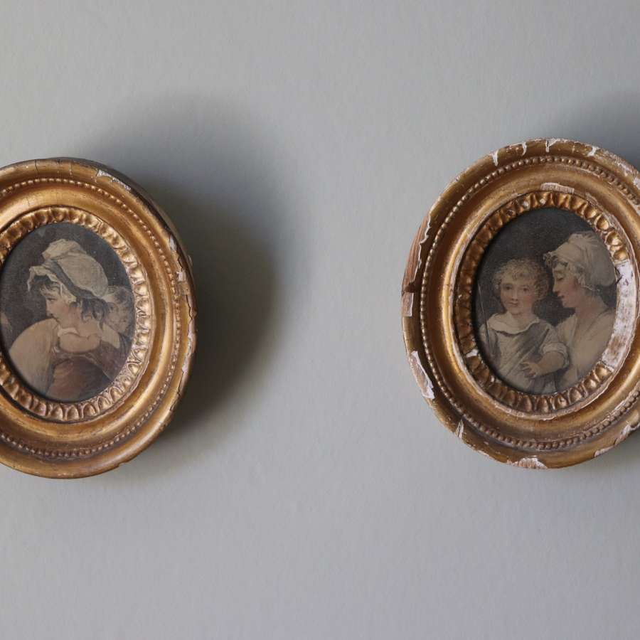 Pair of 19th century gilt frames with prints