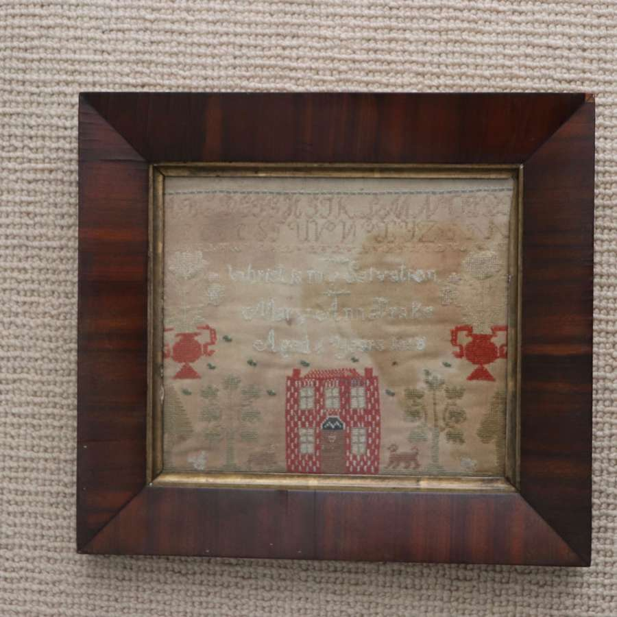 19th century sampler in rosewood frame