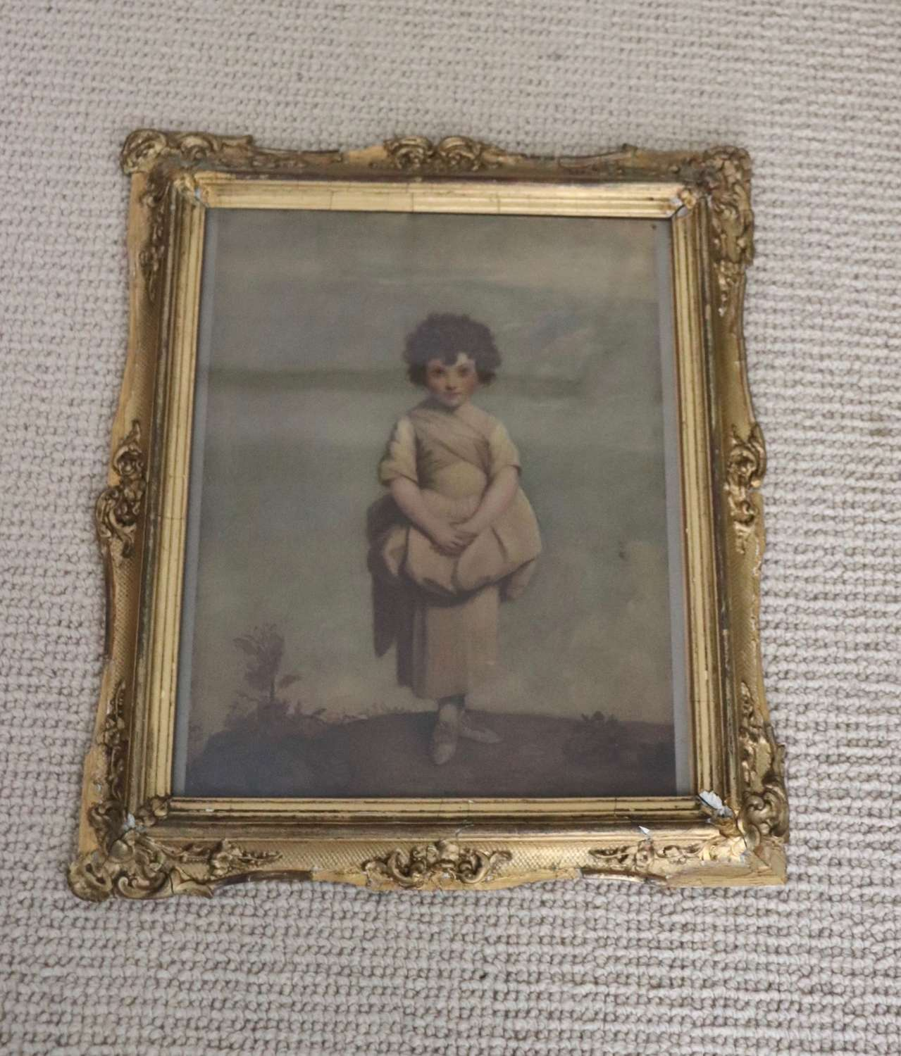 Naive print of a girl in 19th century gilt frame