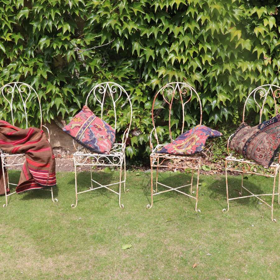 Four mid century iron garden chairs