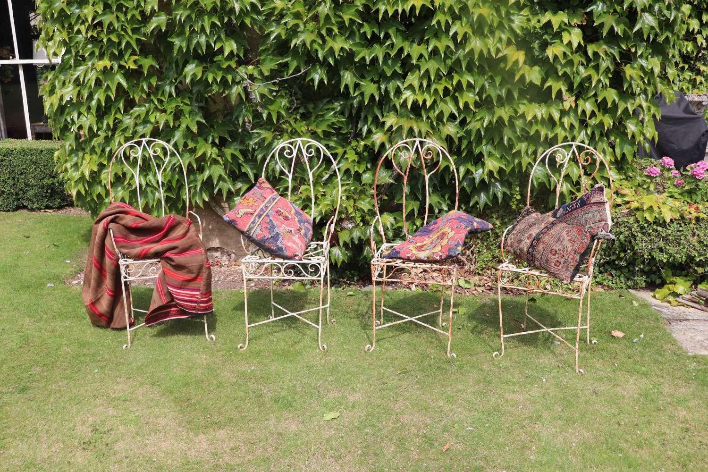 Four mid century iron garden chairs